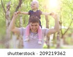 little girl in the arms of his... | Shutterstock . vector #209219362