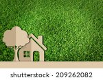 paper cut of family on green... | Shutterstock . vector #209262082