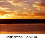 orange sunrise on a lake in... | Shutterstock . vector #2093403