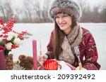 beautiful girl in the park in... | Shutterstock . vector #209392492