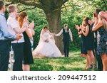 Bride And Groom Running Betwee...