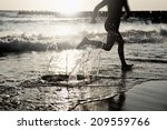 at the sea   running on the... | Shutterstock . vector #209559766