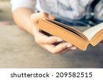 closeup woman hand  holding... | Shutterstock . vector #209582515