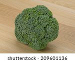 fresh broccoli on the desk   Shutterstock . vector #209601136