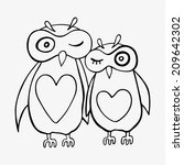 two cute decorative owls.... | Shutterstock .eps vector #209642302
