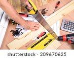 a man made a piece of furniture ... | Shutterstock . vector #209670625