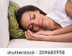 radiant woman sleeping on sofa... | Shutterstock . vector #209685958