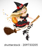 beautiful witch with candy in...