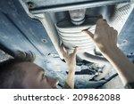 male mechanic replacing exhaust ... | Shutterstock . vector #209862088
