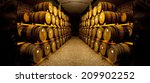 Wine Barrels Stacked In The Ol...