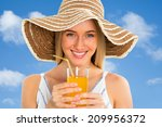 Pretty woman with orange juice - stock photo