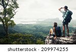 hikers relaxing on top of the...   Shutterstock . vector #209974255