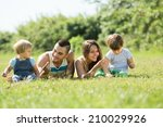 happy young family with little...   Shutterstock . vector #210029926