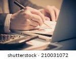 businessman analyzing... | Shutterstock . vector #210031072
