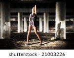 Sexy woman posing in dark industrial zone. Shallow dof. - stock photo
