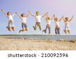 group young friends enjoying a... | Shutterstock . vector #210092596