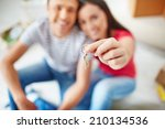 hand of young woman holding key ... | Shutterstock . vector #210134536