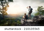 hikers relaxing on top of the...   Shutterstock . vector #210135565