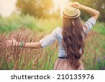 beauty young girl outdoors... | Shutterstock . vector #210135976