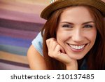 smiling girl in hat | Shutterstock . vector #210137485
