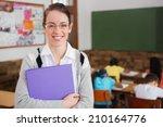 pretty teacher smiling at... | Shutterstock . vector #210164776