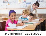 cute pupils drawing at their... | Shutterstock . vector #210165082