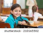 cute pupil smiling at camera at ... | Shutterstock . vector #210165502