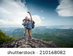 couple of hikers taking photo... | Shutterstock . vector #210168082