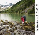 hiker is walking by mountain...   Shutterstock . vector #210169132