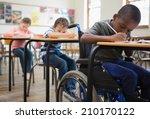 cute pupils writing at desks in ... | Shutterstock . vector #210170122