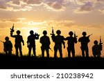 Silhouette Of  Soldiers Team...