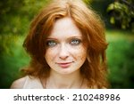Portrait Of Redhead Girl With...