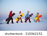 group of snowboarders on top of ... | Shutterstock . vector #210362152