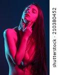 beautiful sexy girl in studio ... | Shutterstock . vector #210380452