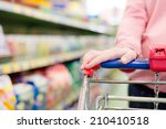 woman in a supermarket trolley... | Shutterstock . vector #210410518