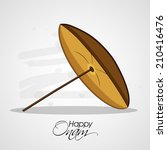 Traditional umbrella in brown color on grey background for South Indian Festival Happy Onam celebrations.