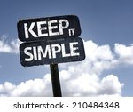 Stock photo keep it simple sign with clouds and sky background 210484348