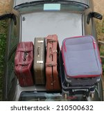 bags on the roof of the car | Shutterstock . vector #210500632