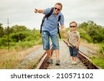 happy family walking on the... | Shutterstock . vector #210571102