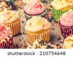 Colorful Cupcakes Frosted With...