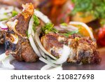 pieces of meat on plate closeup | Shutterstock . vector #210827698