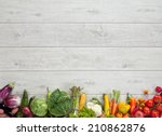 Stock photo healthy food background studio photography of different fruits and vegetables on wooden table 210862876
