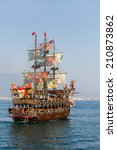 Small photo of ALANYA -TURKEY - JULY 01: Pirate ship showed in the coast in Alanya beach for Feast of cabotage on july 01, 2014 in Alanya Turkey. 01 July 2014. Ship traveling around Alanya castle