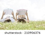 relaxed young couple reading... | Shutterstock . vector #210906376