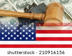 Gavel And Handcuffs On Money...