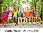 funny group of kids on bench... | Shutterstock . vector #210948526