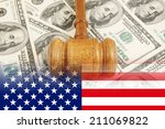 judge gavel on usa dollar... | Shutterstock . vector #211069822