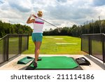 Young Woman Practices Her Golf...