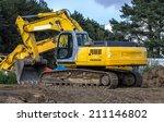 Excavator At A Road...