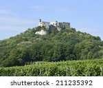 vineyard and the ruins of...   Shutterstock . vector #211235392